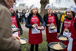 © Licensed to London News Pictures. 13/02/2018. London, UK. Jo Coburn, Laura Hughes and Liz Bates of the Media team practise ahead of the Rehab Parliamentary Pancake Race 2018 in Victoria Tower Gardens. The Parliament Team - made up of MPs, Lords and Ladies - race in a relay against the Media Team - made up of reporters and presenters - whilst continuously flipping pancakes to celebrate Shrove Tuesday, also known as Pancake Day. Photo credit : Tom Nicholson/LNP
