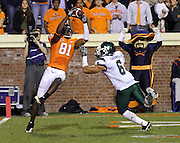 Oct 23, 2010; Charlottesville, VA, USA;  Virginia Cavaliers wide receiver Dontrelle Inman (81) can't hang onto the ball in front of Eastern Michigan Eagles cornerback Marty Cardwell (6) during the 1st half of the game at Scott Stadium.  Mandatory Credit: Andrew Shurtleff