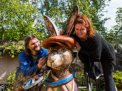 Chris Rutterford paints giant hare for Leuchie House Art Trail, Midlothian, Scotland, UK: <br /> Pcitured: Chris Rutterford and his partner and artistic collaborator, Lubi Lyken, Scottish mural artist, best known recently for painting a mural in Colinton Tunnel, is helping Leuchie House celebrate its 10th anniversary by painting a giant fibreglass hare which, along with 9 other hares, will form a public art trail called The Big Hare Trail in North Berwick from July. The hare sculptures will be auctioned to raise money for the cahrity which offers respite for people living with neurological disorders.<br /> Sally Anderson | EdinburghElitemedia.co.uk
