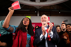© Licensed to London News Pictures. 11/12/2019. London, UK. Leader of the Labour Party Jeremy Corbyn (R) on stage with Shadow Women & Equalities Secretary Dawn Butler (L) at the end of the party's final election rally of the campaign. Voters will head to polling stations tomorrow for the 2019 General Election. Photo credit: Rob Pinney/LNP