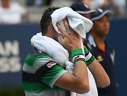 September 4, 2018 - Flushing Meadow, NY, U.S. - FLUSHING MEADOW, NY - SEPTEMBER 04: John Isner (USA) struggles with soaring temperatures during his quarter-final match of the Men's Singles Championships of the US Open on September 4, 2018, at the Billie Jean King Tennis Center in Flushing Meadow, NY. (Photo by Cynthia Lum/Icon Sportswire) (Credit Image: © Cynthia Lum/Icon SMI via ZUMA Press)