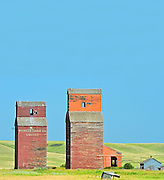 Old wooden grain elevators in ghost town <br /> Neidpath<br /> Saskatchewan<br /> Canada