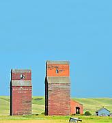 Old wooden grain elevators in ghost town <br /> Neidpath<br /> Saskatchewan<br /> Canada
