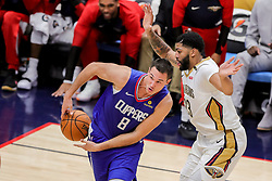 October 23, 2018 - New Orleans, LA, U.S. - NEW ORLEANS, LA - OCTOBER 23:  LA Clippers forward Danilo Gallinari (8) dribbles against New Orleans Pelicans forward Anthony Davis (23) on October 23, 2018, at Smoothie King Center in New Orleans, LA. (Photo by Stephen Lew/Icon Sportswire) (Credit Image: © Stephen Lew/Icon SMI via ZUMA Press)