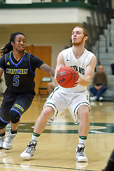 07 December 2016:  Nick Coleman inside of Juwan Henry during an NCAA men's division 3 CCIW basketball game between the North Park Vikings and the Illinois Wesleyan Titans in Shirk Center, Bloomington IL