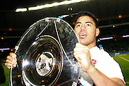Picture by Andrew Tobin/SLIK images +44 7710 761829. 2nd December 2012. Manu Tuilagi holds the Hilary Shield aloft after the QBE Internationals match between England and the New Zealand All Blacks at Twickenham Stadium, London, England. England won the game 38-21.