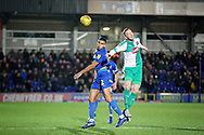 AFC Wimbledon defender Tennai Watson (2) wins this header during the EFL Sky Bet League 1 match between AFC Wimbledon and Plymouth Argyle at the Cherry Red Records Stadium, Kingston, England on 26 December 2018.