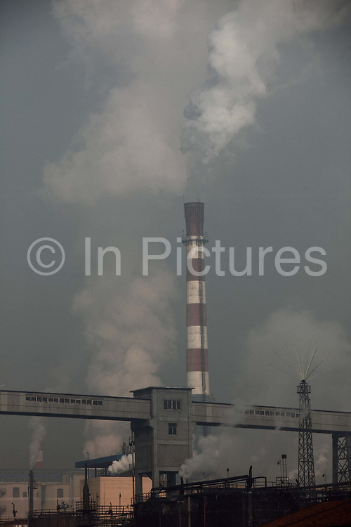 A coking factory - coal firing power station complex belches exhaust into the air in Linfen, Shanxi Province, China on Thursday, 03 December, 2009. Due to the heavy presence of coal mines and related industries, Linfen was named the world's most polluted city from 2004-2007.