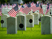 23 MAY 2020 - DES MOINES, IOWA: American flags fly on the headstones of military veterans in the veterans' section of Glendale Cemetery in Des Moines on Memorial Day weekend.      PHOTO BY JACK KURTZ