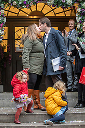 © Licensed to London News Pictures. 31/12/2019. London, UK. Rebecca Steinfeld and Charles Keidan one of the first opposite sex civil partnerships to take place in the country at Chelsea Registry Office on the Kings Road this morning pictured with their children Ariel 2 and Eden 4. As hundreds of opposite sex couples celebrate from the 31 December the formalisation of their relationship with a civil partner. Photo credit: Alex Lentati/LNP