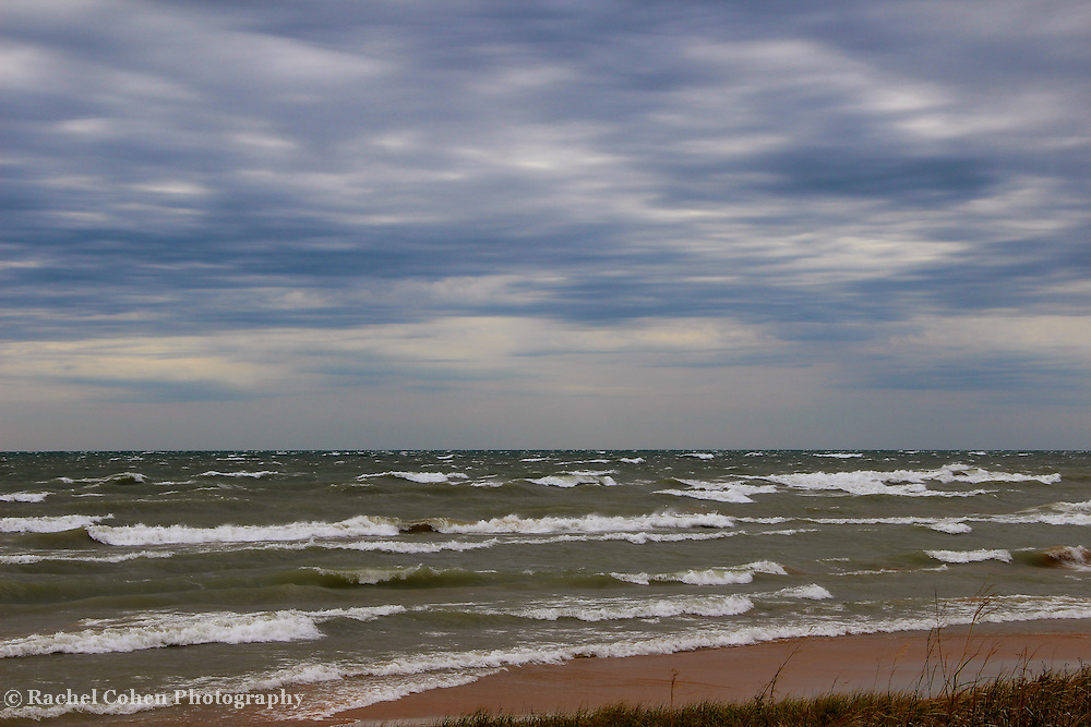 """""""Pummeling the Shores""""<br /> <br /> A storm rolls in on Lake Michigan bringing with it beautiful clouds, strong winds and rolling waves!!<br /> <br /> The Great Lakes by Rachel Cohen"""