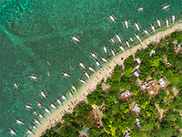 Aerial view of beach, buildings, filipino boats, Balicasag Island, Philippines.