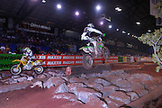 Many riders jumped over the rock pit, while others were forced to navigate the rocks at the 2007 Maxxis AMA Endurocross at the Lazy E Arena in Guthrie, Oklahoma.  Event was won by David Knight #101 on KTM