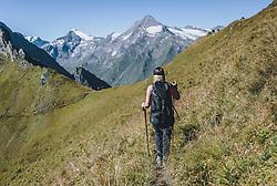 THEMENBILD - eine Frau mit Rucksack und Wanderstöcken geht auf einem Wanderweg in den Hohen Tauern, aufgenommen am 09. September 2020 in Kaprun, Oesterreich // a woman with a rucksack and walking sticks is walking on a hiking trail in the Hohe Tauern. Hike to the Imbachhorn in the Hohe Tauern, which lies between the Fuscher Valley and the Kaprun Valley, in Kaprun, Austria on 2020/09/09. EXPA Pictures © 2020, PhotoCredit: EXPA/Stefanie Oberhauser