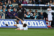 Ashley Williams of Everton (l) clashes with Fernando Llorente of Swansea city (on ground). Premier league match, Swansea city v Everton at the Liberty Stadium in Swansea, South Wales on Saturday 6th May 2017.<br /> pic by  Andrew Orchard, Andrew Orchard sports photography.