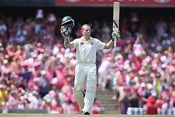 © Licensed to London News Pictures. 05/01/2014. Chris Rogers raises his bat after making his century during day 3 of the 5th Ashes Test Match between Australia Vs England at the SCG on 5 January, 2013 in Melbourne, Australia. Photo credit : Asanka Brendon Ratnayake/LNP