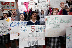 12 Jan 2006.  New Orleans, Louisiana. Post Katrina.<br /> School girls from the academy of the Sacred Heart protest the lack of effective levees in New Orleans as President George Bush comes to town. <br /> Photo; Charlie Varley/varleypix.com