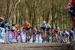 Emma Johansson and Ellen van Dijk lead the peloton up the Kemmelberg for the first time - Women's Gent Wevelgem 2016, a 115km UCI Women's WorldTour road race from Ieper to Wevelgem, on March 27th, 2016 in Flanders, Belgium.