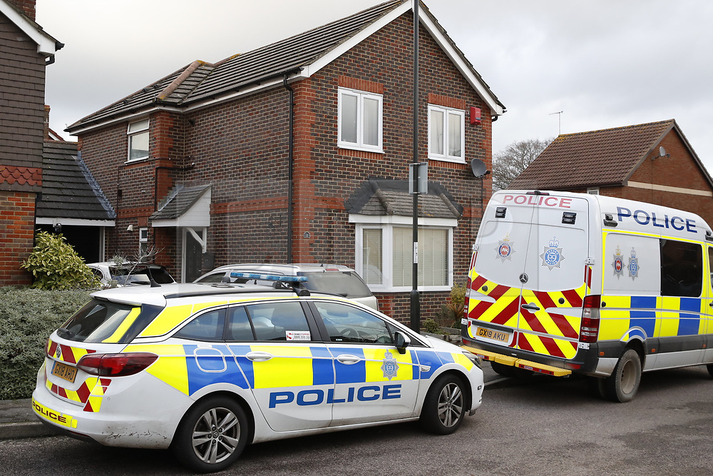 © Licensed to London News Pictures. 22/12/2018. Crawley, UK. Police are seen outside a property in Crawley thought to be in connection to the couple detained by police in connection to the Gatwick drone attacks. Photo credit: Peter Macdiarmid/LNP