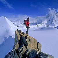 ANTARCTICA. Alex Lowe (MR) climbs Mount Bearskin (2850m) above Patton Glacier in Ellsworth Mountains. 4852m Mount Tyree bkg., 2nd highest peak on continent.