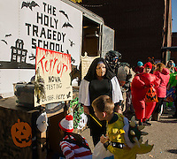 "Sister Donna Hosmer lines up her students for their ""Terror"" Nova Testing during Holy Trinity School's Trunk or Treat on Monday afternoon. (Karen Bobotas/for the Laconia Daily Sun)"
