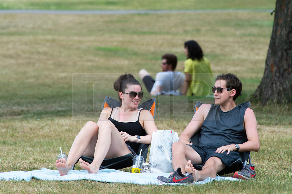 ©Licensed to London News Pictures 15/06/2020<br /> Greenwich, UK. A young couple relaxing. People out and about in Greenwich park, Greenwich, London enjoying the warm sunny weather and Coronavirus lockdown freedom. Photo credit: Grant Falvey/LNP