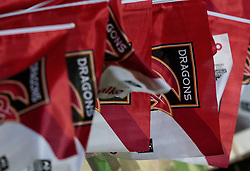 Dragons fans wave flags ahead of the match<br /> <br /> Photographer Simon King/Replay Images<br /> <br /> Guinness Pro14 Round 10 - Dragons v Ulster - Friday 1st December 2017 - Rodney Parade - Newport<br /> <br /> World Copyright © 2017 Replay Images. All rights reserved. info@replayimages.co.uk - www.replayimages.co.uk