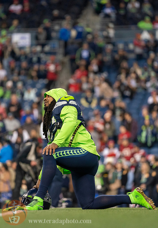 December 29, 2019; Seattle, Washington, USA; Seattle Seahawks running back Marshawn Lynch (24) stretches before the game against the San Francisco 49ers at CenturyLink Field.