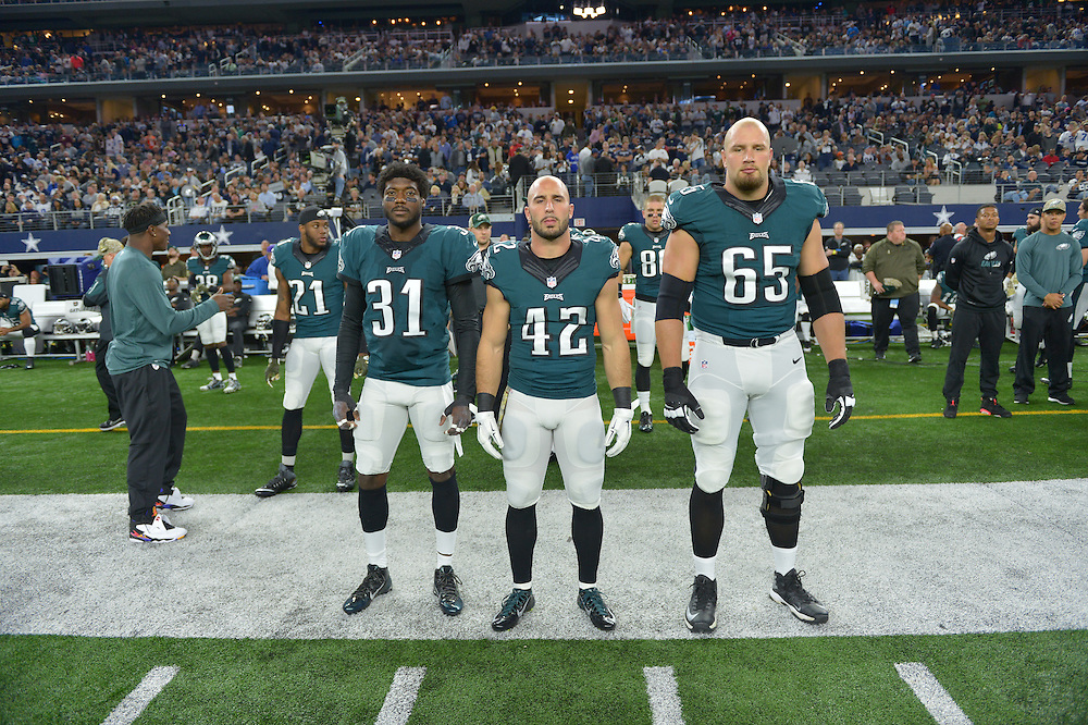 Captains cornerback Byron Maxwell #31, free safety Chris Maragos #42,tackle Lane Johnson #65 against the Dallas Cowboys at AT&T Stadium on November 8, 2015 in Arlington, Pennsylvania. The Eagles won 33-27. (Photo by Drew Hallowell/Philadelphia Eagles)
