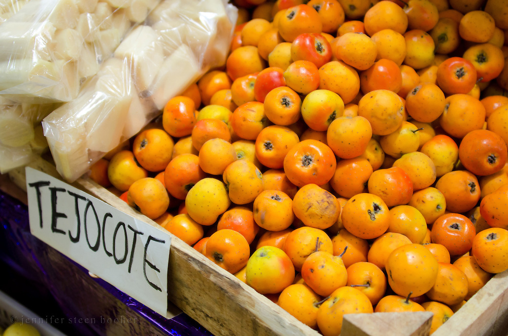 Tejocote fruit (Crataegus mexicana) at the Mercado Benito Juárez, Oaxaca, Mexico. Tejocote are related to hawthorn and crabapple.
