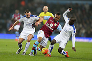 Jordan Ayew of Aston Villa © is challenged by Danny Drinkwater (l) and Ngola Kante (r) of Leicester city. Barclays Premier league match, Aston Villa v Leicester city at Villa Park in Birmingham, The Midlands on Saturday 16th January 2016.<br /> pic by Andrew Orchard, Andrew Orchard sports photography.