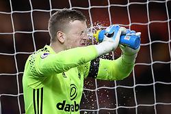Sunderland goalkeeper Jordan Pickford splashes his face with water