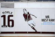 An advertising board shows a graphic of Mark Noble, West Ham United captain displayed on the side of the London Stadium. Premier league match, West Ham Utd v West Bromwich Albion at the London Stadium, Queen Elizabeth Olympic Park in London on Saturday 11th February 2017.<br /> pic by John Patrick Fletcher, Andrew Orchard sports photography.
