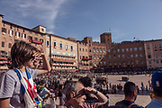 "Italy, Siena, the Palio: people waiting for the11 am trial called "" Provaccia"" , the bad trial, for the lack of enthuasiasm shown by the jockeys who spare the horses for the demanding evening race"