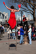 Buskers perfors for a crowd along the Southbank. London