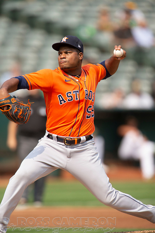 Sep 25, 2021; Oakland, California, USA; Houston Astros pitcher Framber Valdez (59) delivers a pitch against the Oakland Athletics during the second inning at RingCentral Coliseum. Mandatory Credit: D. Ross Cameron-USA TODAY Sports