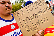 10 APRIL 2006 - PHOENIX, AZ: SELVIN SUCHITE, an undocumented immigrant from Guatemala who has been in the US for 20 years, demonstrates in favor of the immigration bill proposed by Arizona Sen. John McCain and Massachusetts Sen. Ted Kennedy during an immigration demonstration in Phoenix, AZ. More than 200,000 people participated in a march for immigrants's rights in Phoenix Monday. The march was a part of a national day of action on behalf of undocumented immigrants. There were more than 100 such demonstrations across the US Monday. Protestors were encouraged to wear white, to symbolize peace, and wave American flags, to demonstrate their patriotism to the US.  Photo by Jack Kurtz