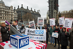 London, UK. 25 November, 2019. Activists wearing Donald Trump and Boris Johnson masks carve up the NHS during a protest by campaigners from Keep Our NHS Public, Health Campaigns Together, We Own It and Global Justice Now in Parliament Square to call on Prime Minister Boris Johnson to end privatisation of healthcare in the National Health Service (NHS).