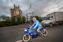 stock photo of a man riding a motorbike in russia