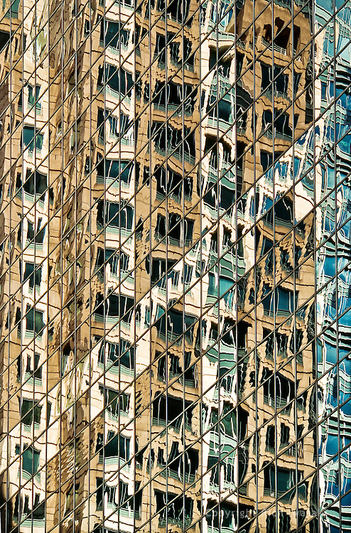 Detail view of wnidow reflections of One South Wacker building, Chicago, Illinois