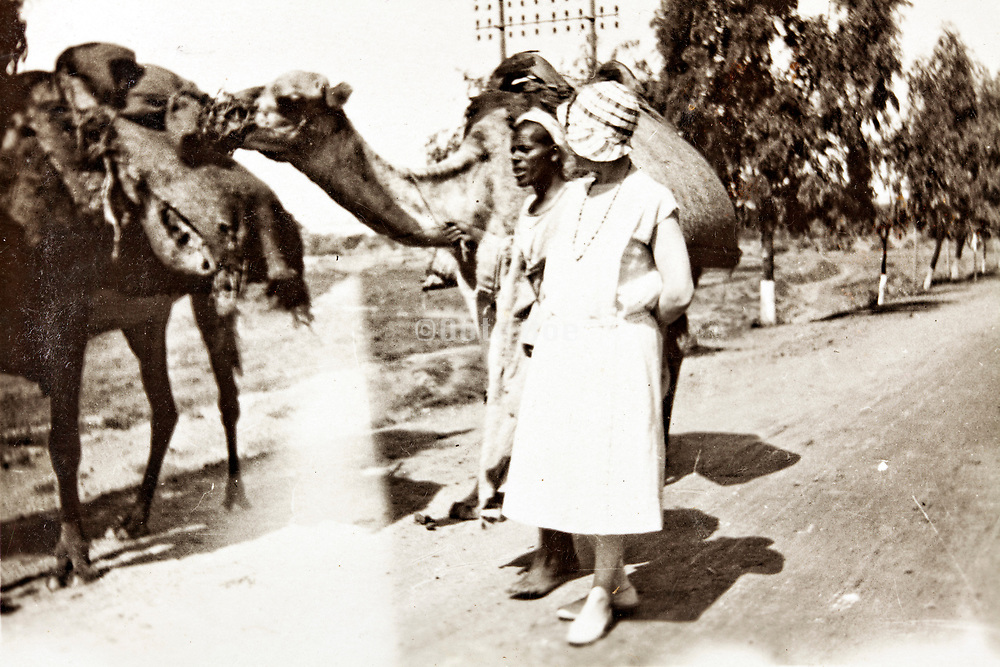 western woman with a camel caravan trades person Morocco 1930s