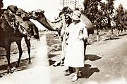 western woman with a camel caravan trades person Morocco 1930s