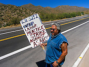 09 JULY 2005 - KEARNY, AZ: Workers picket the entrance to the Asarco copper mine in Kearny, AZ. Workers are claiming Asarco, now owned by Mexican conglomerate Grupo Mexico, is not bargaining in good faith.    PHOTO BY JACK KURTZ