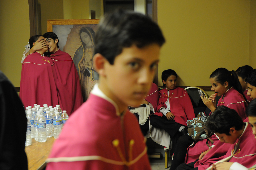 Members of Niños Cantores de Morelia prepare, some jokingly, for their performance before a packed audience at St. Gall Parish on Chicago's southwest side.