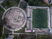 In this Sept. 22, 2017 photo, the pre-Columbian archeological site La Luz is flanked by a private soccer field players rent in Lima, Peru. Many people in modern-day Peru are raised among the Incan ruins built before the Spanish colonized South America.