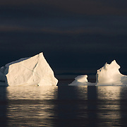 Chunks of the Ilulissat Kangerlua Glacier, the world's most prolific glacier outside of Antarctica, clutter the Jakobshavn Icefjord near the town of Ilulissat, Greenland.