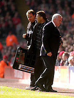 Photo. Glyn Thomas.<br /> Liverpool v Leeds Utd. Barclaycard Premiership.<br /> Anfield, Liverpool. 25/10/03.<br /> An angry Leeds manager Peter Reid (R) is restrained by the fourth official as refereeing decisions fail to go his way.