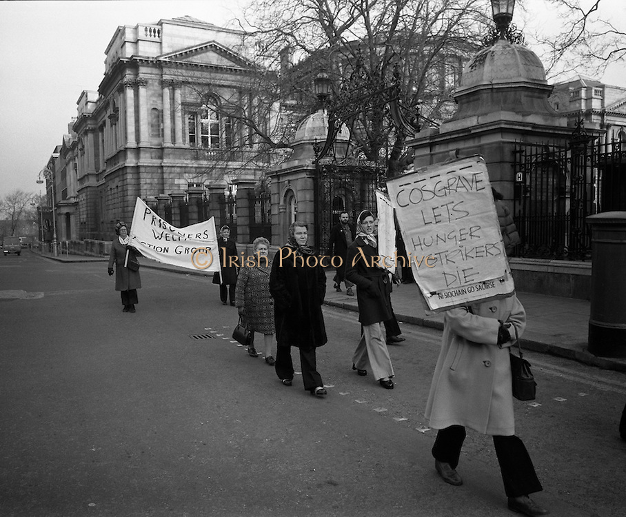 Portlaoise prison Hunger Strike Picket..1975..04.12.1975..12.04.1975..4th December 1975..As part of an ongoing protest to gain political status several I.R.A. members jailed in Portlaoise prison went on hunger strike. The inmates stated that their status as criminals was wrong as they were fighting for Irish freedom and not engaging in otherwise criminal activity. As the protest continued at the prison, a picket was placed on Leinster House in Dublin by family of those taking part in the hunger strike. The purpose of the picket was also to draw attention to the conditions pertaining in the prison at the time. Portlaoise prison is Ireland's maximum security prison,it is used to house those convicted of paramilitary activities as well as hardened dangerous  criminals. .Picture shows the family members of those on hunger strike picketing the Dail at Leinster House, Dublin.