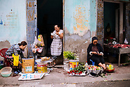 Early morning daily life scene in a small street of Nam Dinh, Vietnam, Southeast Asia