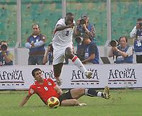 Photo: Steve Bond/Richard Lane Photography.<br />Egypt v Angola. Africa Cup of Nations. 04/02/2008. Andre Macanga (upper) vaults tha challange of Abd-rabou Hosni (lower)